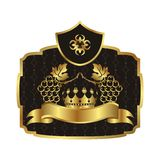 Gold label with grapevine with crown Stock Images