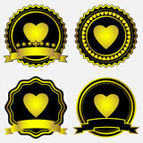 Gold labels with hearts Royalty Free Stock Photo