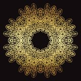 Gold lace pattern on a black background. Gold mandala. Gold pattern Royalty Free Stock Images