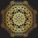 Gold lace pattern on a black background. Royalty Free Stock Images
