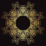 Gold lace pattern on a black background. Royalty Free Stock Photo
