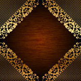 Gold lace on wooden background Royalty Free Stock Images