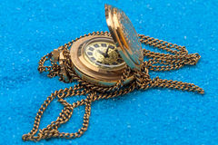 Gold ladies watch on chain Stock Image