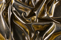 Gold lame. Scrunched up gold lame fabric Stock Photo