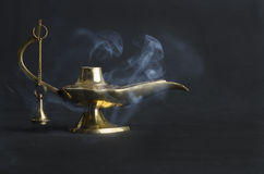 Gold lamp of the East. With a smoke Stock Photos