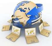 Gold laptops around the globe Royalty Free Stock Photo