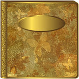 Gold leaf album cover. A view of an textured, gold leaf album or book cover with metallic butterfly designs and a blank nameplate stock illustration