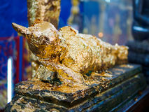 Gold leaf on Buddha statue at Wat Chaiyamangalaram Penang Malaysia Royalty Free Stock Photo