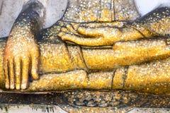 Gold leaf covered leg of buddha Stock Photo