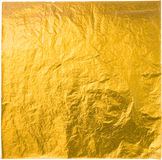 Gold leaf. Isolated on a white background Stock Image