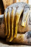 Gold leaf offerings on slender fingers Royalty Free Stock Photography