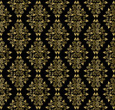 Gold leaf pattern on a black background Royalty Free Stock Photography