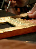 Gold leaf processing. During restoration working Royalty Free Stock Photo