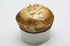 Gold leaf souffle. Amazing souffle made with chocolate and real gold leaf, unique stock photo