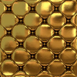 The gold leather texture of the quilted skin Stock Photos