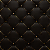 The gold leather texture of the quilted skin. The gold texture of the leather quilted skin royalty free stock photos