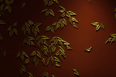 Gold leaves on a red wall, background and texture. Golden leaves on a red wall, backgrounds and textures Royalty Free Stock Images