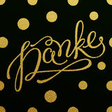 Gold lettering design for card Danke Stock Images