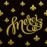 Gold lettering design for card Merci Stock Photos