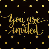 Gold lettering design for card You Are Invited Stock Photo