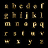 Gold letters. Of the alphabet in lower case Royalty Free Stock Photo