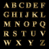 Gold letters. Of the alphabet in upper case Royalty Free Stock Photo