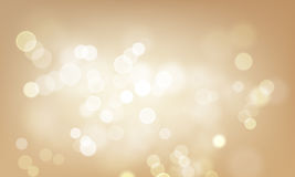 Gold light blur glitter or sparkling defocused vector background. Gold light glittering vector background. Defocused shimmering blur effect of golden shine Stock Image
