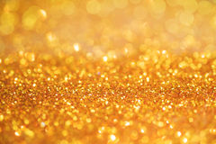 Gold light bokeh texture or glitter lights festive gold background. Christmas abstract template.  royalty free stock photos