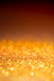 Gold light bokeh texture or glitter lights festive gold background. Christmas abstract template stock images