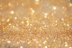 Gold light bokeh texture or glitter lights festive gold backgrou. Nd. Christmas abstract template Stock Photo