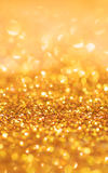 Gold light bokeh texture or glitter lights festive gold background. Christmas abstract template stock photography