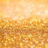 Gold light bokeh texture or glitter lights festive gold background. Christmas abstract template royalty free stock image