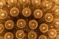 Gold light glass balls chandelier Royalty Free Stock Photography