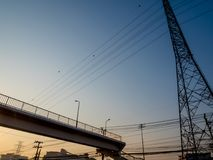 Gold light of morning sunrise and the street overpass in the cit. Gold light of morning sunrise, overpass and electicity power supply tower in the city Royalty Free Stock Photo