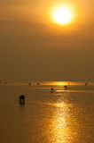 Gold light of the sunrise. On morning time beside the seaside with fishermen village Stock Photography