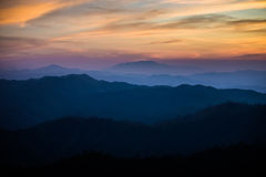 Gold light. Of sunset is beautiful. And blue mountains are background royalty free stock photo