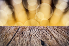 Gold lights scene with wooden table Royalty Free Stock Photos