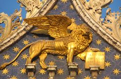 Gold lion on St Mark's Basilica, Venice. Gold lion on starred blue background of St Mark's Basilica, Venice - Italy Stock Image