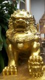 Gold lion statue. The statue was built by faith. The Chinese Thailand It is believed that Lion statue will be guarded no good. Protecting prevent threats to Stock Photos