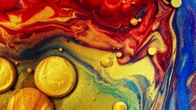 Gold liquid paint bubbles. Abstract color background. real beautiful substance flows.