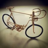 Gold little iron bike. Bike. Gold. Colour. Iron. Metal Royalty Free Stock Images