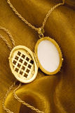 Gold locket. On a chain Stock Photography