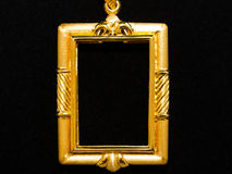 Gold locket frame pendant Royalty Free Stock Image