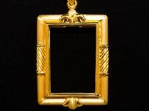 Gold locket frame pendant Royalty Free Stock Image