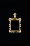 Gold locket frame pendant Royalty Free Stock Photos