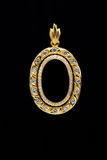 Gold locket frame pendant with diamond. On black background Stock Images