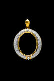 Gold locket frame pendant with diamond. On black background Royalty Free Stock Photos