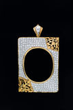 Gold locket frame pendant with diamond. Gold rectangle shape locket frame pendant with diamond on black background Royalty Free Stock Photos