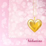 Gold locket on pink Stock Photography