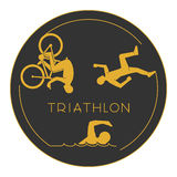 Gold logo triathlon. Gold figures triathletes. Royalty Free Stock Photo